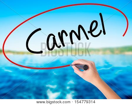 Woman Hand Writing Carmel With A Marker Over Transparent Board
