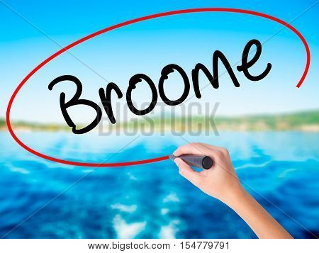 Woman Hand Writing Broome With A Marker Over Transparent Board.