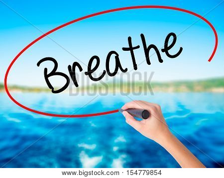 Woman Hand Writing Breathe   With A Marker Over Transparent Board