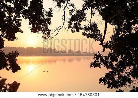 Sunrise over the lake. Poland . .