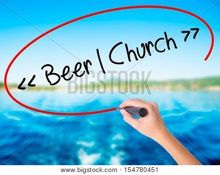 Woman Hand Writing Beer - Church With A Marker Over Transparent Board.