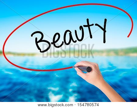 Woman Hand Writing Beauty  With A Marker Over Transparent Board