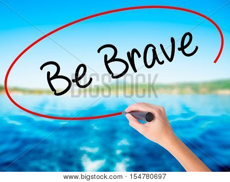 Woman Hand Writing Be Brave With A Marker Over Transparent Board