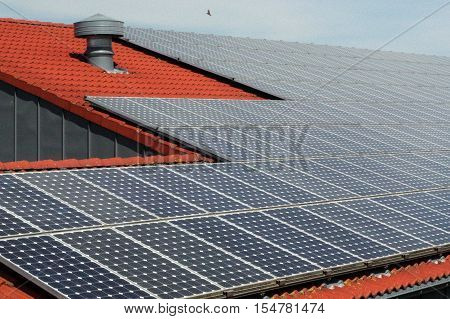 a Roof with solar photovoltaic panels photovoltaic