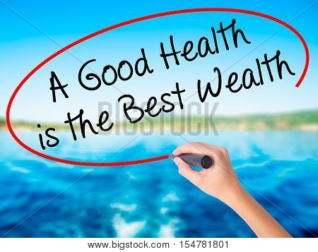 Woman Hand Writing A Good Health Is The Best Wealth With A Marker Over Transparent Board