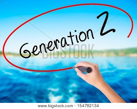 Woman Hand Writing Generation Z With A Marker Over Transparent Board