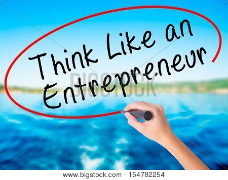 Woman Hand Writing Think Like An Entrepreneur With A Marker Over Transparent Board