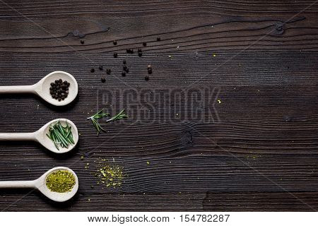 spices for cooking on dark wooden table top view