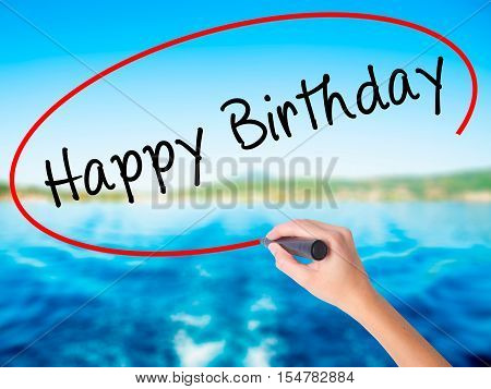 Woman Hand Writing Happy Birthday With A Marker Over Transparent Board