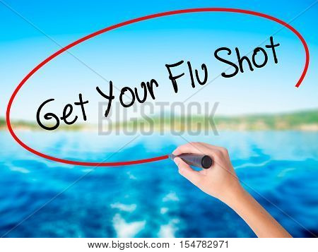 Woman Hand Writing Get Your Flu Shot With A Marker Over Transparent Board