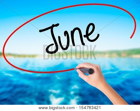 Woman Hand Writing June  With A Marker Over Transparent Board
