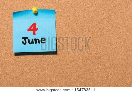 June 4th. Day 4 of month, color sticker calendar on notice board. Summer time. Empty space for text.