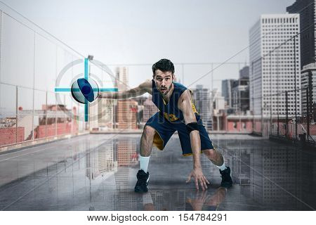 Full length portrait of a basketball player with a ball against gray city background