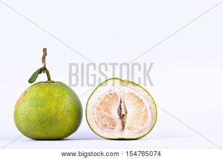 fresh green pomelos and half  pomelo on white background healthy fruit food isolated