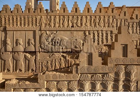 Achaemenid bas relief carvings on side panels of staircase toward the castle in Persepolis UNESCO World Heritage Site near Shiraz Iran.