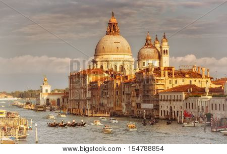 ITALYVENICE - SEPTEMBER 24 2015: Gondolas and boats in the Grand Canal Venice
