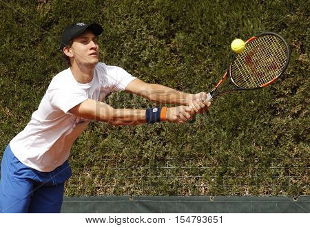 BARCELONA, SPAIN - APRIL, 20: Argentinian tennis player Renzo Olivo  in action during a match of Barcelona tennis tournament Conde de Godo on April 20, 2016 in Barcelona