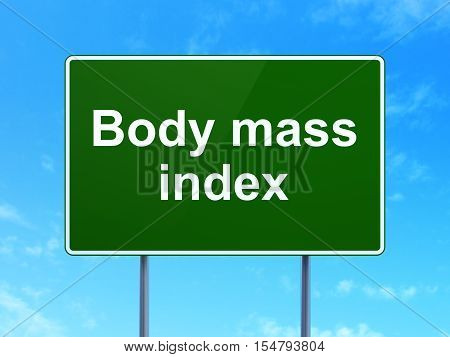 Medicine concept: Body Mass Index on green road highway sign, clear blue sky background, 3D rendering