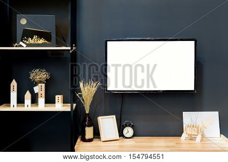 Modern wood shelf with flat TV in living room at home. Living room interior.