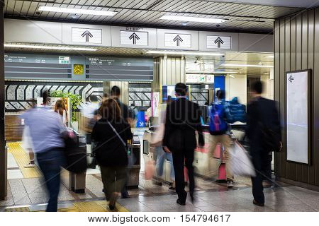 Blurred crowd of people at metro station in Tokyo Japan. Metro is a major transportation in Tokyo.