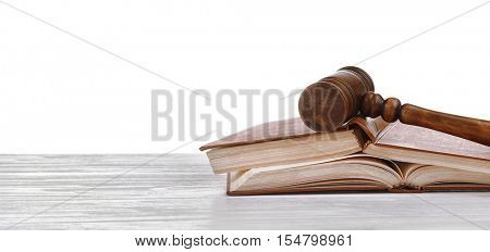 Judge's gavel and books on white background