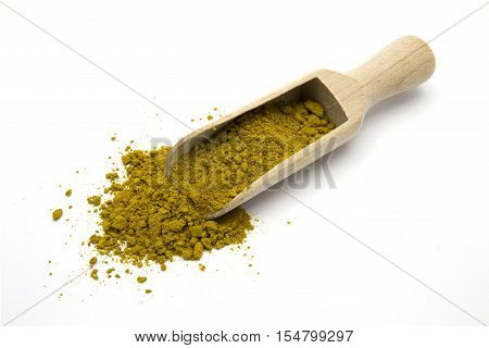 Scoop with curry on white isolated background