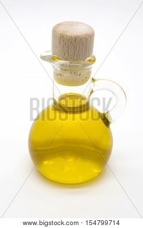 Small olive oil bottle with cork on white isolated background
