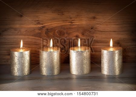 Noble candles in front of a wooden background for celebratory moments