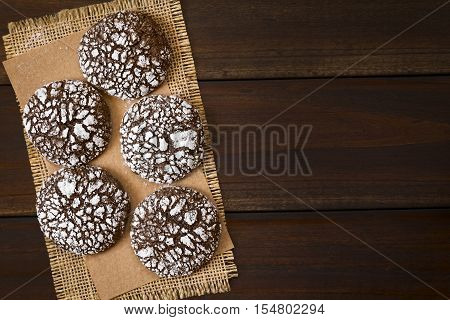 Chocolate crinkle cookies traditional American Christmas cookies photographed overhead on dark wood with natural light