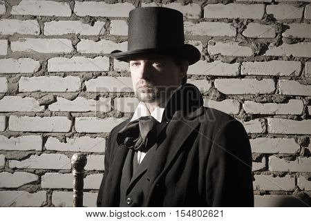 Victorian Man In The Black Coat, Top Hat And In A Tie