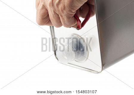 Open blank tin canister for chemical liquids and products in hands in position pouring.
