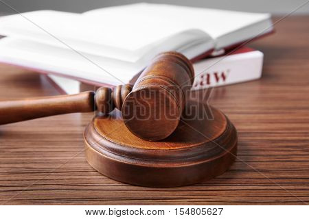 Judges gavel and books on wooden table