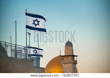Flag of Israel. Dome of the Rock in the old city of Jerusalem, Israel.
