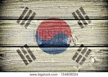 flag of South Korea painted on old grungy wooden background: 3d illustration