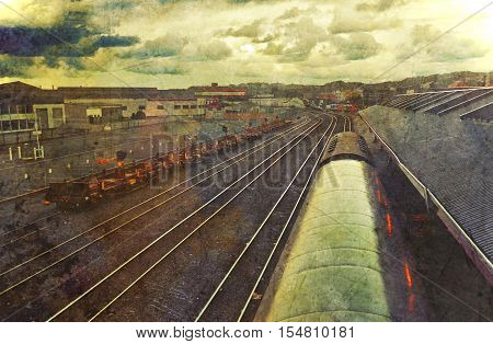 Grunge vintage textured train carriages at station and railway tracks under dramatic sky at dusk, Dunedin, New Zealand