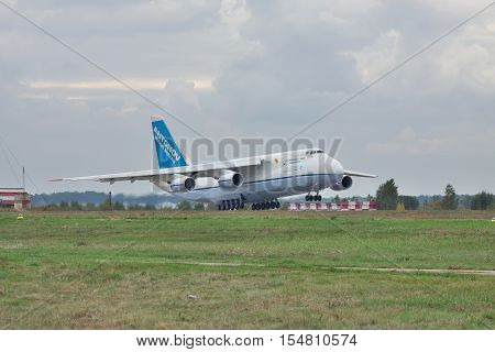 Kiev Region Ukraine - October 2 2010: Antonov Design Bureau An-124 cargo plane is landing on a cloudy day