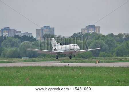Kiev Ukraine - July 27 2011: Yakovlev Yak-40 regional passenger jet plane is landing on a cloudy day