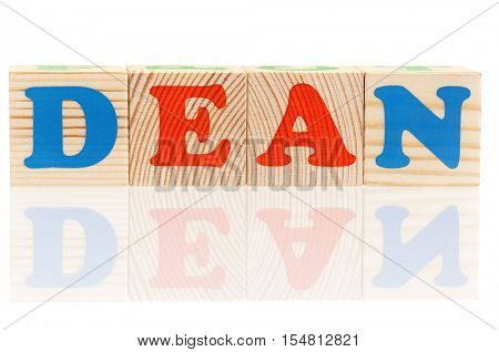 Dean word formed by colorful wooden alphabet blocks, isolated on white background