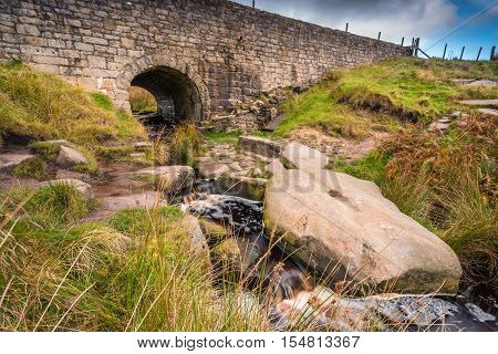 Upper Burbage Bridge East, with the Burbage Brook flowing under it, located in the Peak District National Park