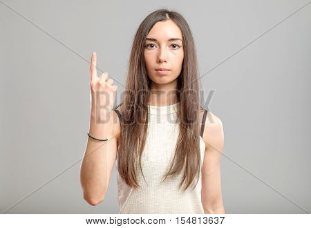 Woman Showing Her Index Finger Up