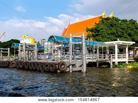 Bangkok, Thailand - December 8, 2015: Route of Chao Phraya Express Boat approach to the Kiak Kai Pier Bangkok Thailand. Chao Phraya Express Boat is a popular method of transporting passengers.