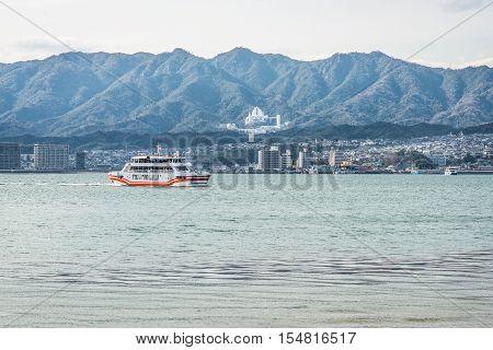 Ferry-boat in island of Miyajima - Hiroshima Japan. View from the Miyajimaguchi city pier