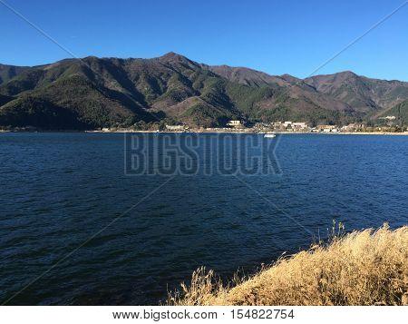 Kawaguchi-ko Lake with township at sunny day in Japan.