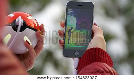Samara, Russia - November 1, 2016: woman playing pokemon go on his iphone. pokemon go multiplayer game with elements of augmented reality.