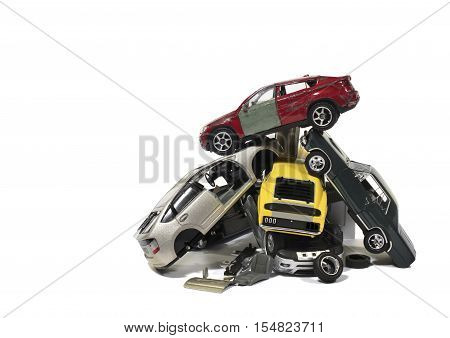 Still Life of a Pile of Used Model Wrecked Cars in Junkyard on White Background