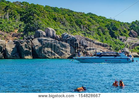 Phang Nga, Thailand - January 4, 2016: View from the tour boat to the Similan Island Andaman Sea Thailand. Couple snorkeling and diving in crystal blue water.