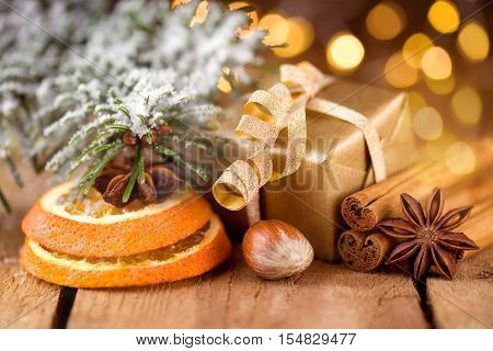 Golden Christmas gift with spices and bokeh effect
