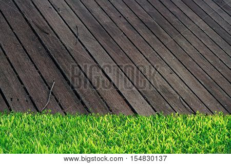 Wooden Floor in household with green grass. use to be background for put some stuff on wooden slat.