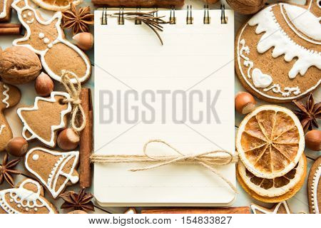 Background. A notebook and a set of gingerbread. Holidays Christmas and New year