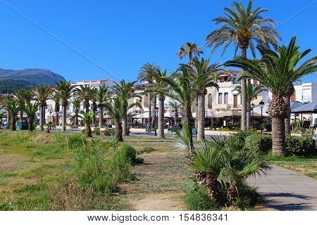 street with palm trees in Rethymnon (Greece)